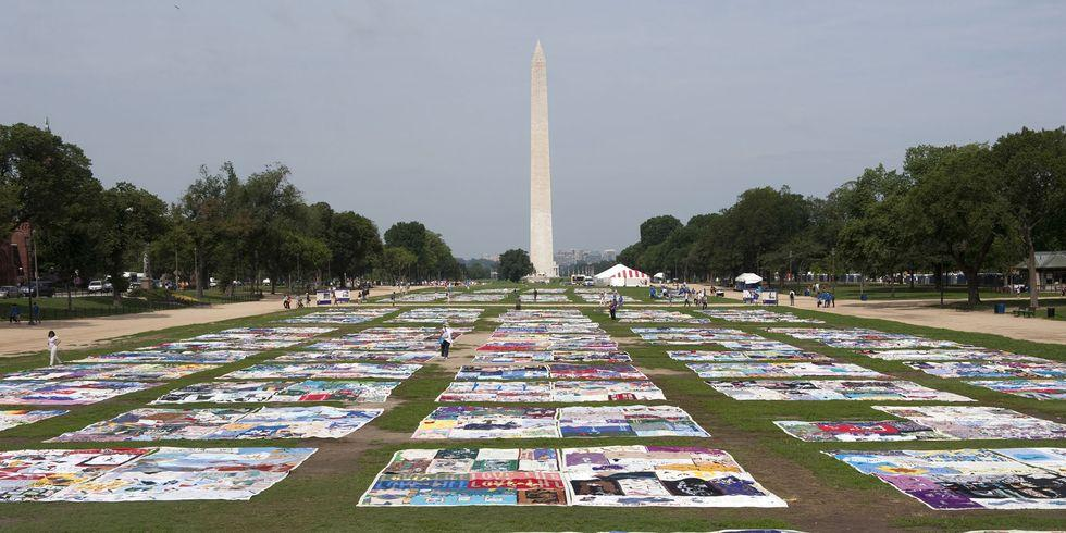 A photo of the AIDS memorial quilt, which is a large collection of hand made quilts filled with names of people who have passed away due to the virus.